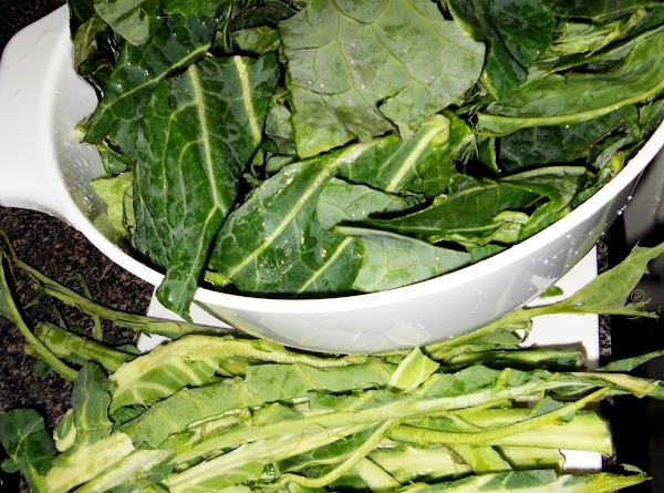If using fresh collard leaves, strip the leaves from the center stalk and if...