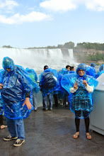 """Photo: We had so much fun with Feraz's friends, we almost missed the last Maid of the Mist tour at Niagara Falls (the purpose of our whole trip!). Feraz parked the car at 6:35 and we ran towards the ferris wheel looking for where to buy tickets. We ran down the main road once we saw the water and just made it on to the last boat! Woo-hoo! One thing we have learned traveling together- when one person says, """"Run!"""" just do it and ask questions later."""