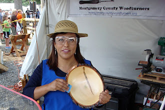 Photo: Imelda Rocha shows her impressive natural-edge bowl.