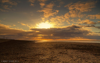 Photo: The Giants Above Us  How many times do you go about your day without seeing what your day is bringing you?  I was stood on Southport beach in the UK, its known for the tide going right out so you can walk along the beach, as I looked down the beach I could see the sun above the clouds casting a light through the lower clouds onto the people into the distance. What I also noticed was no one seeing what was there, even the warm glow from the late autumn sun, the glittering of the sun hitting the areas of water trapped in the sand gave them a clue to look up.  Don't miss what the day will give you, it might only be moments of wonder but it will keep you going for a long time.