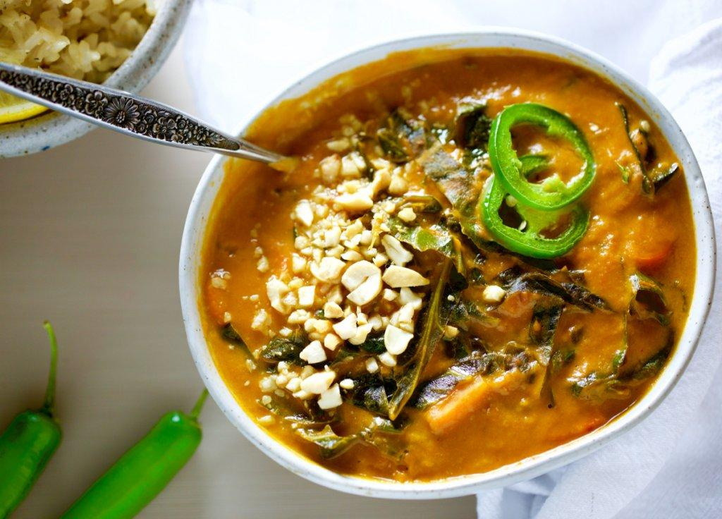 Close up of Top View of bowl of African Peanut Stew with spoon in it