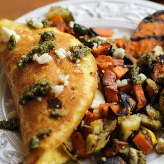 Leftover Grilled Vegetable Omelet with Pesto Sauce and Feta Cheese.