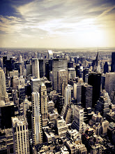 """Photo: """"Dissolving...""""  Looking out over New York City from up high, the skyscrapers rise from the ground proudly as if they are marching towards the horizon where the city and the sky meet briefly and where steel dissolves into light.   New York Photography: The Chrysler Building and New York City skyline as seen from the Empire State Building.    This photo was taken and edited with my phone using Camera +. I am @newyorklens on Instagram (view my feed here: http://goo.gl/8hbcE ). You can check out some of my mobile photography on Flickr here: http://goo.gl/BxNpG .    View this post if you wish at my site here:  http://nythroughthelens.com/post/30900574728/the-chrysler-building-and-new-york-city-skyline-as    Tags: #photography  #newyorkcity  #newyorkcityphotography  #nyc  #manhattan  #city  #urban  #mobilephotography  #iphonography  #iphoneography  #iphone  #landscape  #architecture"""
