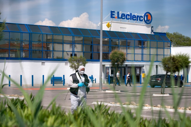 "A member of the French Forensic police walks in the grounds of a supermarket where two people were injured when a woman shouting ""Allah akbar"" (God is greatest) attacked two people with a boxcutter on June 17, 2018 in La Seyne-sur-Mer, southern France."