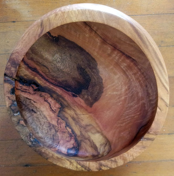 """Photo: Eucalyptus bowl. The striations are the result of working with wood that had a burl in it (what I call a """"wart"""").  The burls often found in tall, isolated gum trees."""