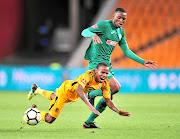 Joseph Molangoane of Kaizer Chiefs tumbles after a  challenge by Butholezwe Ncube of AmaZulu during their Absa Premiership match  at FNB Stadium on Saturday night. The teams played to a goalless draw.