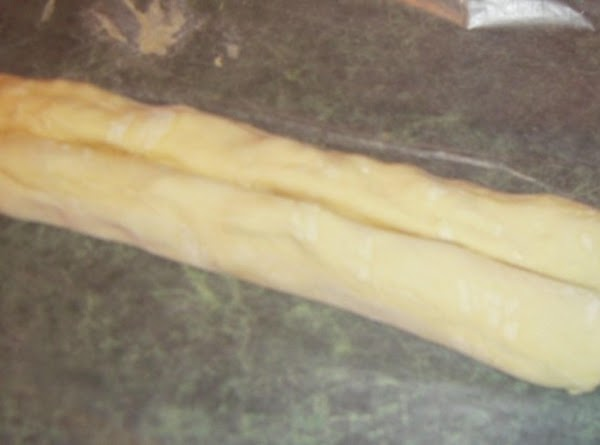 Roll both long ends so that they meet at the center of the dough....