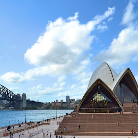 Did you know the opera house comes from Danish design?  by Benjamin Salazar - Buildings & Architecture Public & Historical ( sky, harbor, blue, white, cloud, bridge, opera house, people, sydney,  )