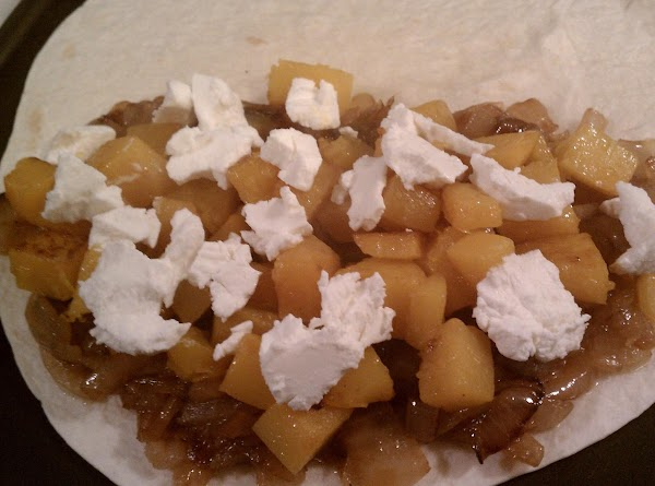 Add some of the squash and top with crumbled goat cheese.  Add a...