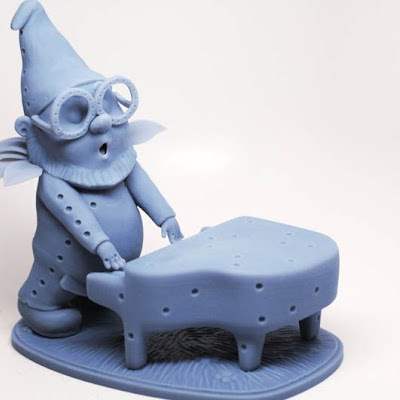 3d printing gallery image of a gnome figurine playing the piano made in polyjet sla resin