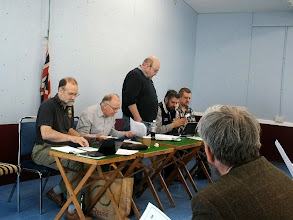 Photo: 006 No photos taken of either the Scout or the Guide halls, except for this one in the Guide hall where at 1pm sharp the formal business of the day got underway. Here is the 009 Society Board of Directors at the start of the meeting (I lost concentration after this……..), Left to right: Geoff Bowyer – Treasurer, Alan Rolfe - Membership Secretary, David Gander – Chairman, Charlie Insley – Secretary, Steve Fulljames – 009 News Production Editor, standing in for Contents Editor Tom Dauben, last seen somewhere in Europe on the day of the meeting