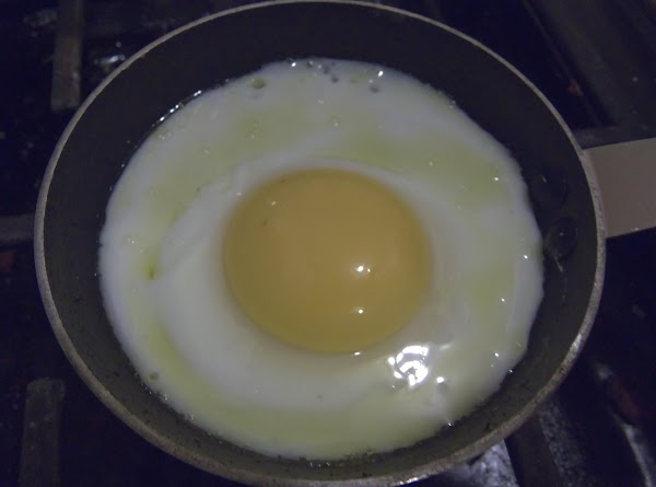 In a frying pan melt some butter and cook the eggs sunny side up...