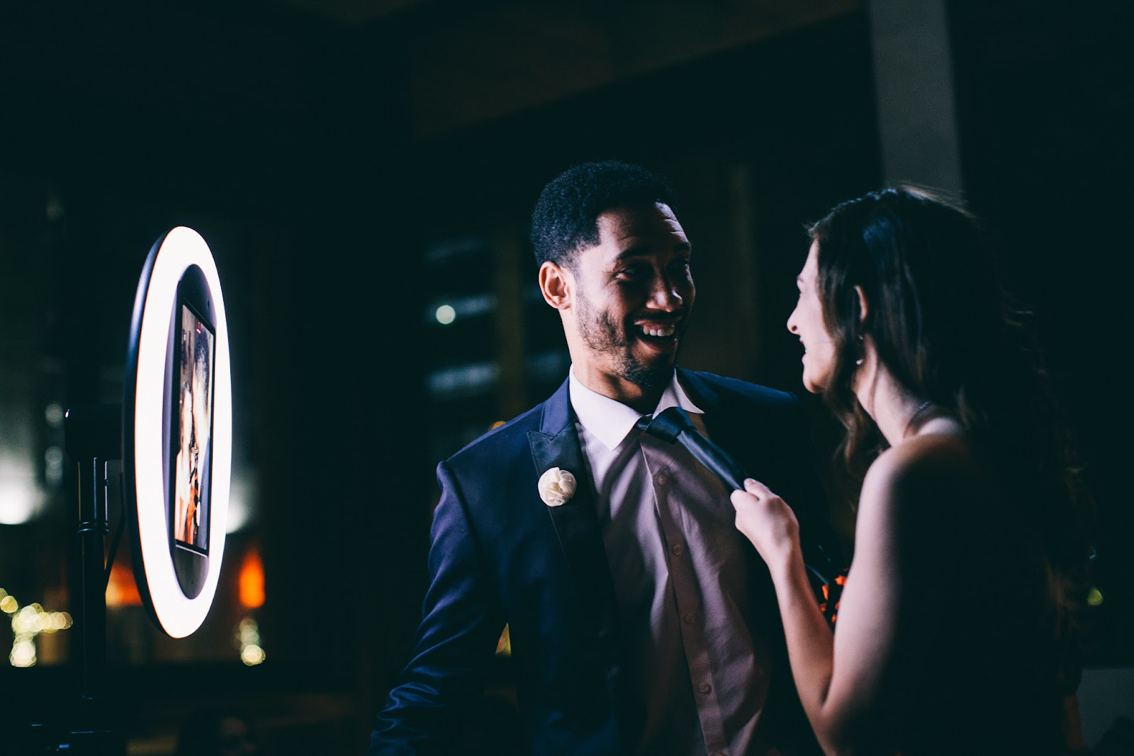 two guests enjoying a wedding photo booth rental