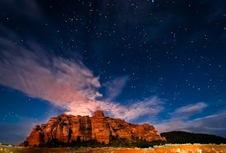 Photo: Night Rock  I'm now home from #PSW2012 and back to the job. I had a great week of meeting people, seeing new things and shooting. Wednesday +Jake Johnson, +Jacob Lucas, +Jennifer Baileyand I rolled up to Zion National Park in Utah to do some shooting.  With Jake's knowledge of the area we got around really easy and got to see some amazing sites. The four of us had a blast getting to know one another better and just goofing off for the day.  The image below was taken just outside the park. I haven't done a whole lot of night shooting but sure do enjoy the results. The moon was just coming up behind me and was lighting up the large rocks and the clouds, the foreground was light painted by +Jacob Lucaswho had the forethought to bring a flashlight torch. The image is still a bit noisy from shooting at 3200 ISO on a cropped sensor but if I remove any more of the noise I start to lose the stars. Still, noise and all, I love this shot.