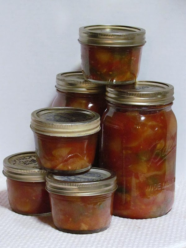 Put into your prepared jars.  Make sure you clean the rim of each...