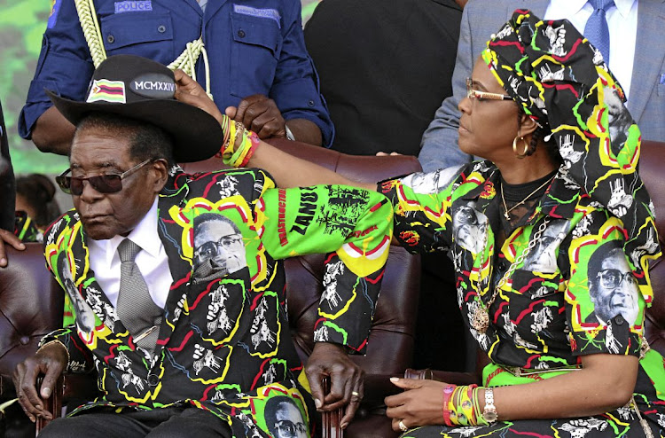 President Robert Mugabe and his wife Grace at a rally of his ruling Zanu-PF in Chinhoyi, Zimbabwe. File photo.