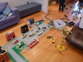 Photo: Basic City set up with train under construction in the background.