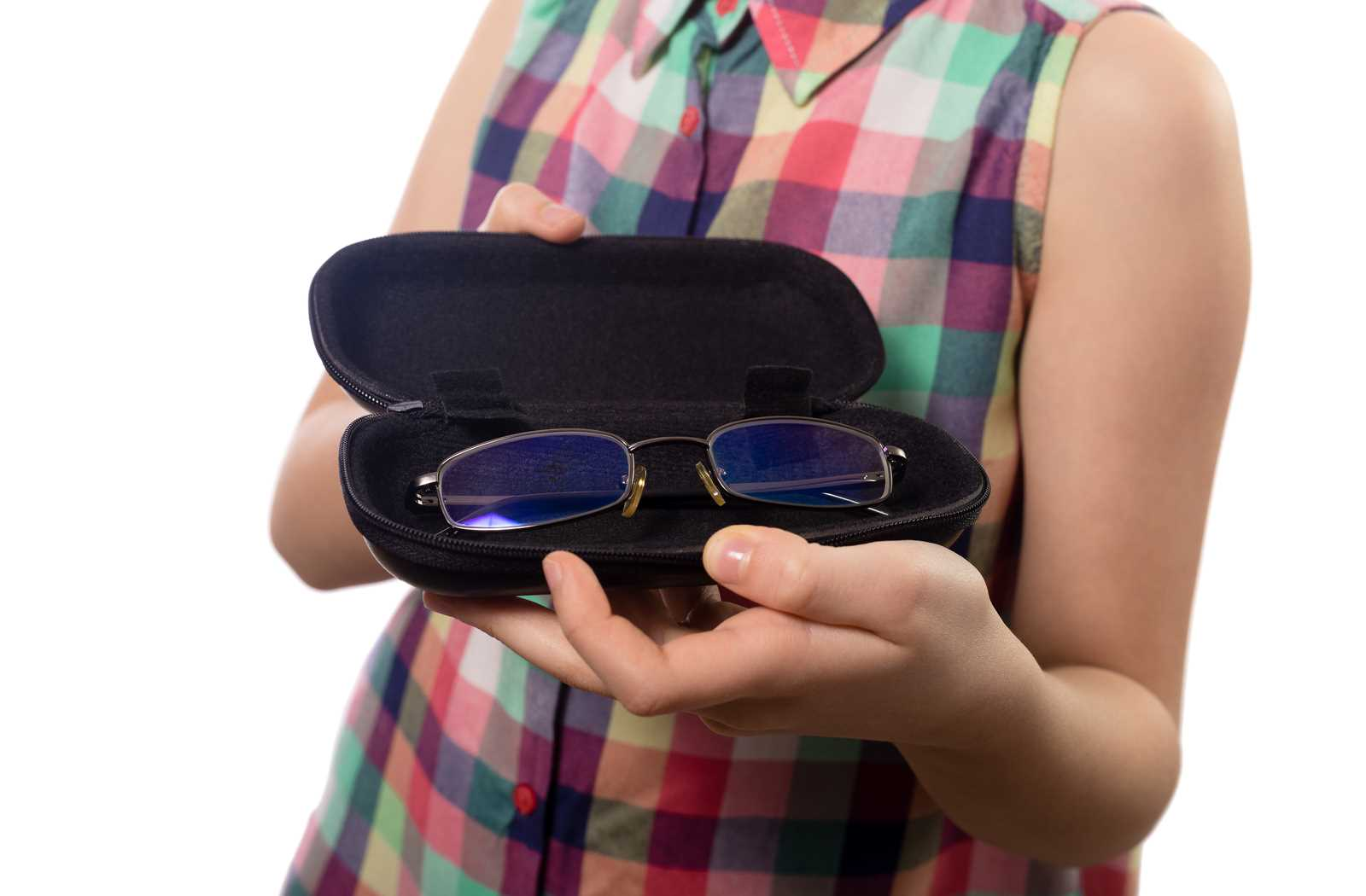 Child showing off a pair of glasses in a black case