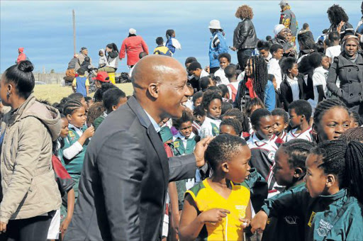 BUILDING UP: Premier of the Eastern Cape, Phumulo Masualle, visited Umzuvukile Sport Development Women's celebrations event in Mdantsane yesterday, where about 900 young girls played rugby as part of a gender-based anti-violence programme Picture: RANDELL ROSKRUGE