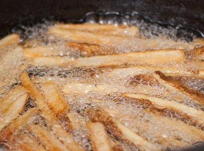 Drain and pat dry potatoes. Drop in 325 degree oil handfull at a time fry...