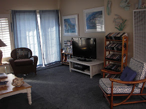 """Photo: Family room, 42"""" TV with DVD's and VHS"""