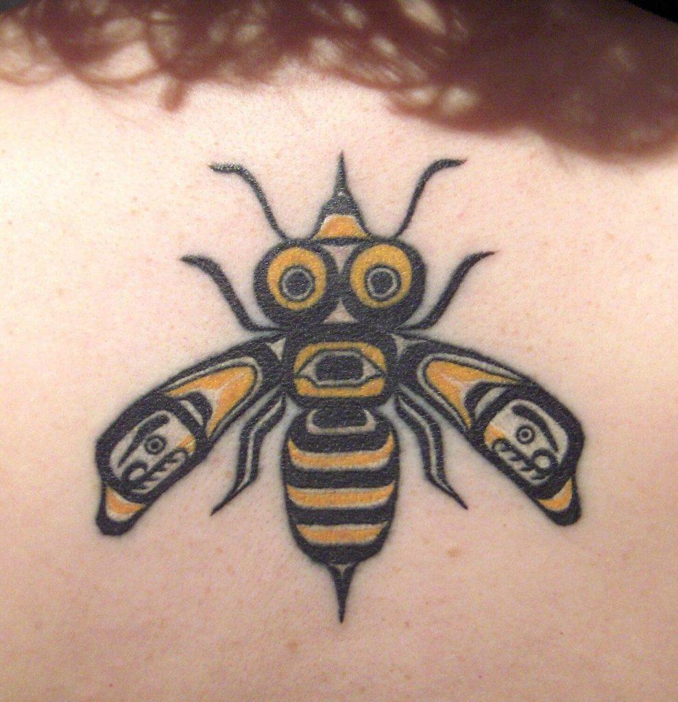 tribal bee tattoo