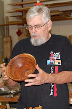 Photo: Ed Karch talks about his end grain bowl.
