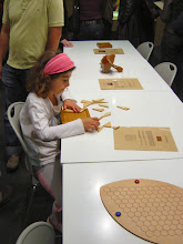 Photo: Hands-on enjoyment at the exhibition of mathematical games.