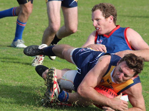 Narrabri Eagles skipper Todd Dunn scrambles with last year's Gillies Medal winner Andrew George for the ball this season. Todd claimed both the 'Coach of the Year' and 'Volunteer of the Year' at the TAFL presentation evening last weekend.