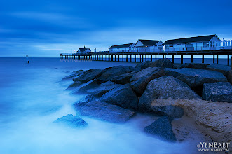 Photo: Twilight | Blue Hour at Southworld Pier - Suffolk, U.K.  Southwold Pier in Suffolk, England was built in 1900. The original pier extended to a distance of 810 feet and finished with a T-shaped end. The pier end was destroyed by a gale in 1934, with the T-shaped end being swept away. More catastrophic events such as World War II and a major storm in 1979 reduced the pier to approximately 100 feet.  When the pier was bought by Chris Iredale in 1987, a major refurbishment program was started to rebuild the pier. This was completed in 2001 almost 100 years after the pier first opened. In 2002 the T-Shaped end was added, bringing the pier to a total length of 623 feet. This additional length now allows the pier to accommodate visits by Britain's only surviving sea-going steam passenger ship, the PS Waverley paddle steamer and its sister ship the M.V.Balmoral.  #Southwold   #Suffolk   #England   #UK   #Travel   #Photography   © Yen Baet - www.YenBaet.com. All Rights Reserved. Join me on Facebook at www.facebook.com/YenBaetPhotography.