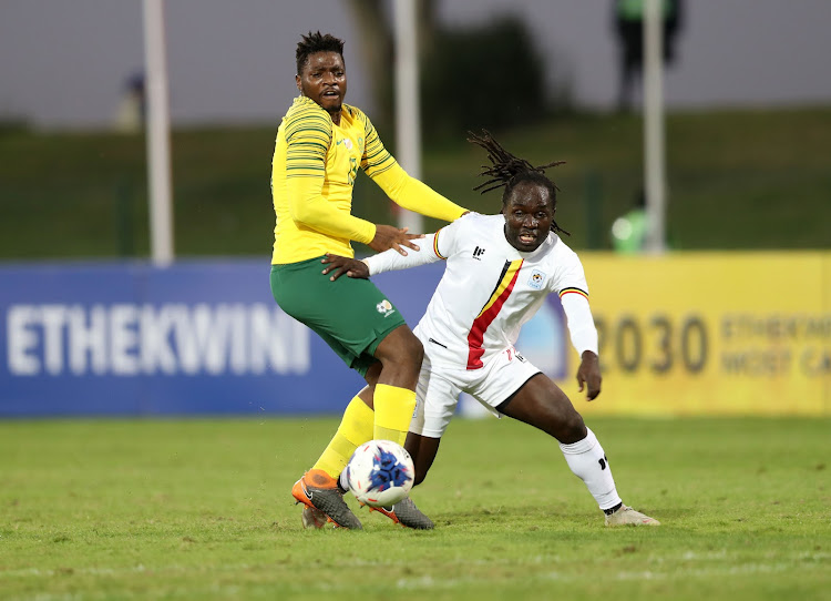 Dan Serunkuma of Uganda is challenged by Thendo Mukumela of South Africa during the 2019 Cosafa Cup match at Princess Magogo Stadium in Durban on June 4 2019.