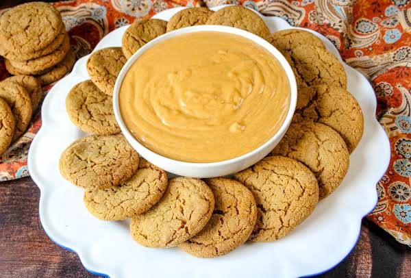 Gingersnap Cookies On A Plate With Pumpkin Dip.