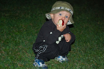 Photo: Squatting in the yard to finish off his apple