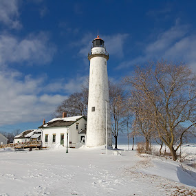 Lighthouse in Winter by Bill Diller - Buildings & Architecture Other Exteriors ( frigid, lighthouse, michigan, great lakes, winter, tranquil, pte.aux barques, peaceful, pte.aux barques lighthouse, calm, wintry, county park, snow, lighthouse county park, calmness, tranquility, lake huron )