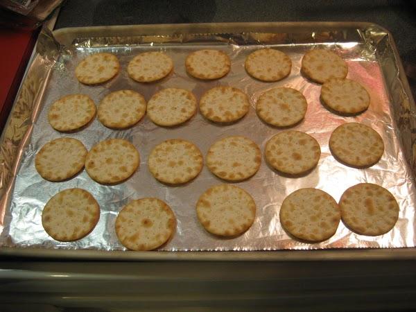 Arrange crackers on baking sheet.