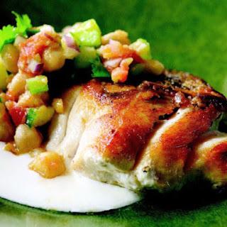 Pan-Roasted Striped Bass with Tunisian Chickpea Salad and Yogurt Sauce.