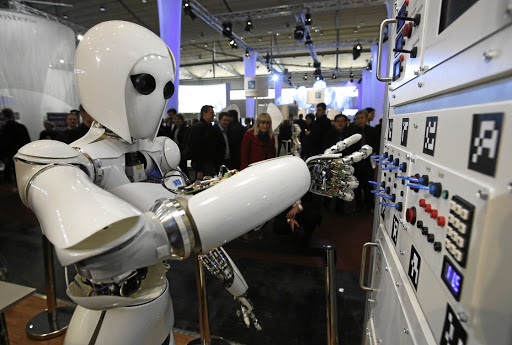 Up for the job: The robot AILA (artificial intelligence lightweight android) operates a switchboard during a demonstration by the German Research Centre for Artificial Intelligence in Hanover. Picture: REUTERS