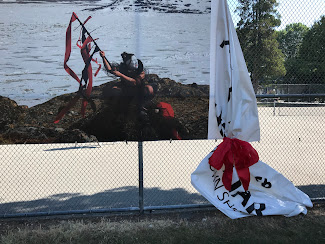 <p> July 11. Red ribbon added temporarily by the artists/curator to send a public message that the banner is actively being cared for and will not be removed.</p>