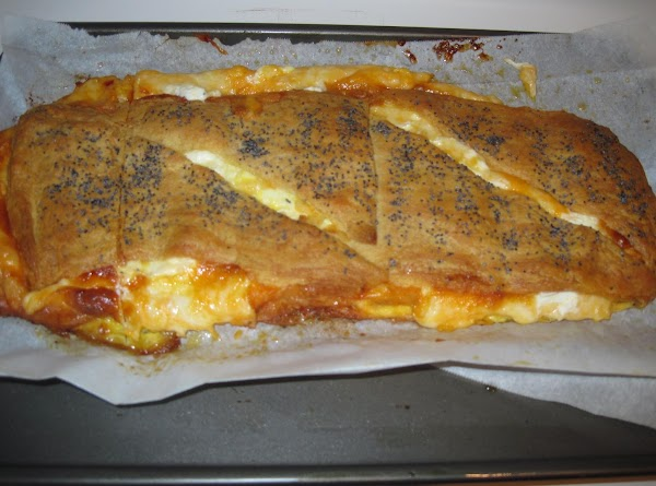 Brush with butter and sprinkle with sesame seeps.  Bake at 350 for 40...