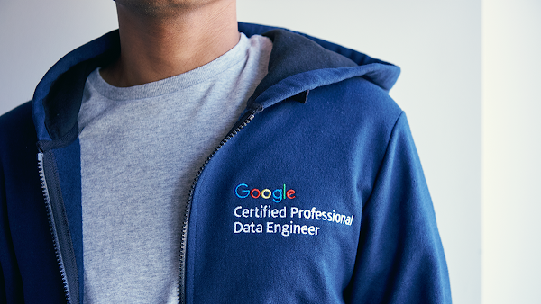 Man wearing a hoodie embroidered with Google Cloud Certified Professional Dat Engineer