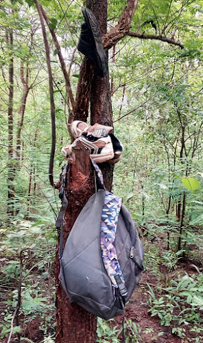 The personal belongings of one of the deceased hung from a nearby tree.. COURTESY BELA BHATIA