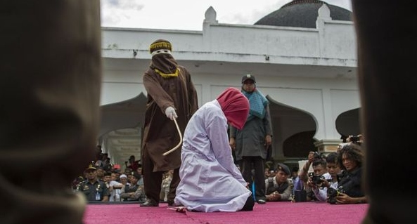 A file photo of a woman being caned publicly previously