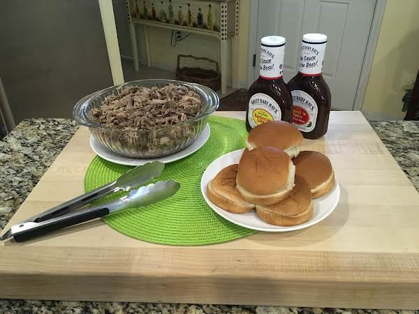 Simply Pulled Pork With Slider Buns And Bbq Sauces.