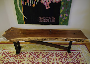 """Photo: Another view of the Walnut slab coffee table, showing the two Nakashima-style """"butterflies"""" at the left, which stabilize a crack.  The steel base was designed and fabricated by my nephew, Kevin, a local metal smith."""