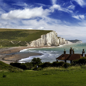 Seven Sisters, Sussex coast, England by Peter Greenhalgh - Travel Locations Landmarks ( clouds, chalk cliffs, england, blue sky, grass, cuckmere haven, sussex, seven sisters, coast )