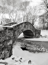 Photo: Snow on a stone bridge in winter Eastwood Park in Dayton, Ohio.