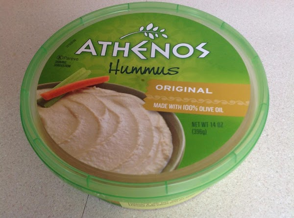 Spread pita with a thick layer of hummus over whole pita.