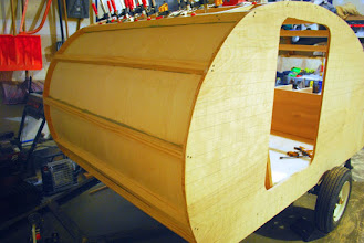 """Photo: Attached interior skin. Just held in place with construction adhesive and clamped for a week to let dry. We did not want any screws showing through on the inside, so we did it this way. 1/8"""" birch plywood makes the ceiling."""