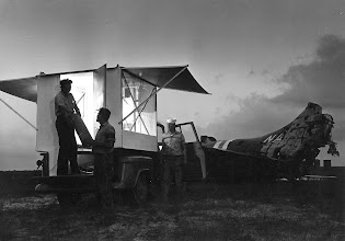 """Photo: No sleeping on the ground for these Chase sailors. The """"Piggy Back"""" trailer angles into the breeze. The men will sleep high and dry at the crash scene."""