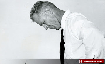 Photo: Wilkinson reflecting on the sideline during the 1953 Notre Dame game.
